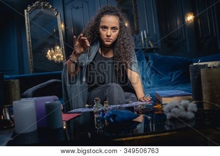 Soothsayer Holding A Crystal Pendulum In Her Hand