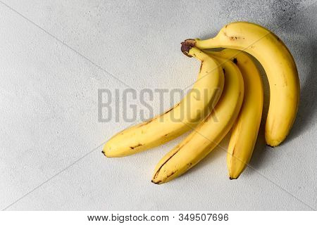 Rotten Spoiled Ugly Bananas Isolated On White. Bunch Of Bananas Isolated On Gray Background. Yellow