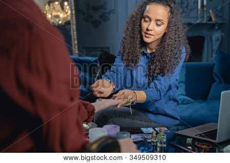 Professional Healer Using Magic Stones For Chakra Balancing