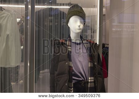 Mannequin In Warm Outerwear On The Window Of A Male And Teen Store