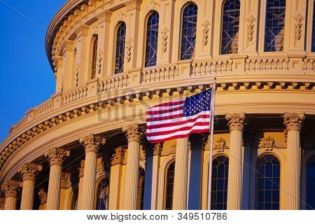 Us Flag Over The United States Capitol Building Home Of The Usa Congress On National Mall In Washing