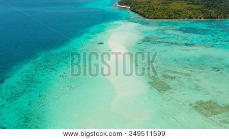Sandy Beach With Tourists Among Turquoise Waters And Coral Reefs. Mansalangan Sandbar. Beach At The