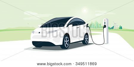 Electric Car On Charging Station With Green City Street Skyline. Battery Ev Vehicle Plugged And Gett
