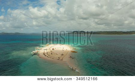 Beautiful Beach On Tropical Island Surrounded By Coral Reef, Sandy Bar With Tourists, Top View. Sand