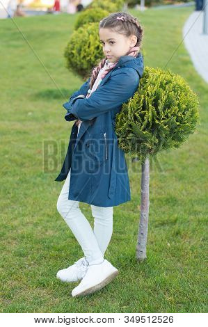 Must Have Concept. Fashionable Coat. Girl Cute Face Braided Hair Posing Coat In Spring Park. Clothin
