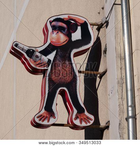 Berlin, Germany - February 5, 2020: Advertisement: A Monkey Holding A Bottle Of German Berliner Kind