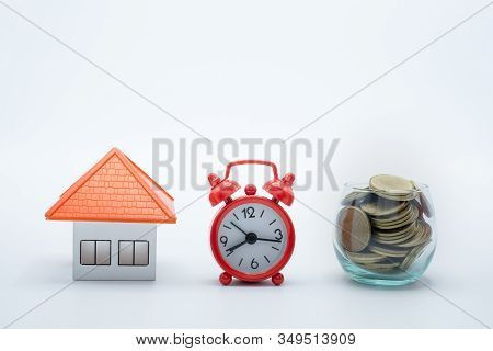 Coin Ladder.stacking Coins On Desk With Clock. Finance And Money Concept.stacked Coins To Save For T