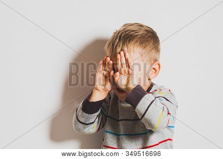 Frustrated Little Boy Crying And Covering His Face