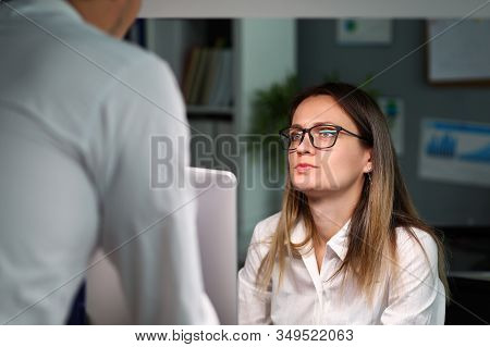 Woman Listening Intensely To Man At Work, Stress. Aversion To Their Work. Deteriorating Relationship