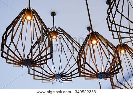 Modern Light Fixtures On A Grey Ceiling