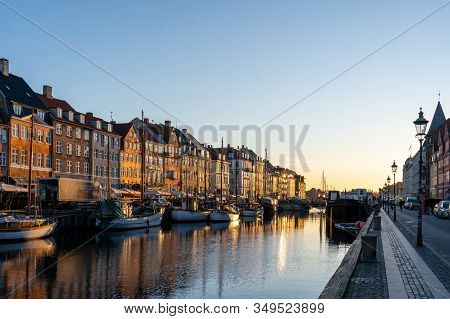 Copenhagen, Denmark - February 02, 2020: Colorful Houses And Boats In Famous Nyhavn During Sunrise.
