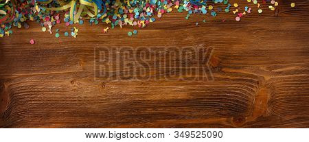 Flat Lay Photography With Colorful Confetti On Wooden Textur. Carnival Background. Top View For Mard