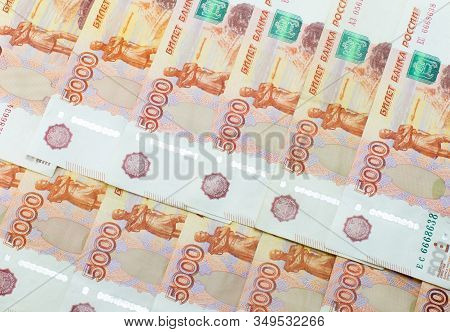 Russian Banknotes 5000 Rubles. Neatly Folded. Background Made Of Money.