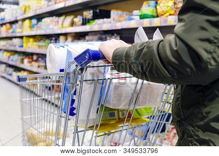 Supermarket Products, Household Goods. Cart For Goods, The Girl Goes Along The Rows Of The Store