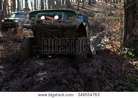 Four By Four Off Road Car Crossing The Mud. Travel And Racing Concept For Four Wheel Drive Off Road