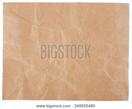 A Blank Sheet Of Plain Brown Craft Paper, Heavily Wrinkled And Creased.  Isolated On White.