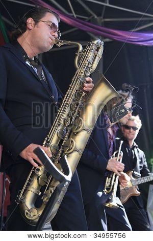 Koen Schouten Plays Baritone Sax With Band Members