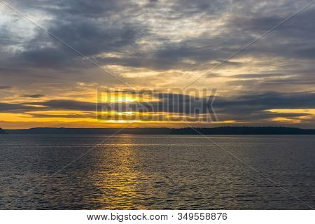An Overcast Cloudy Sunset Over The Puget Sound In West Seattle, Washington.