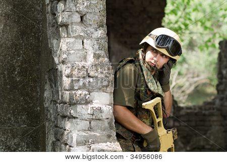 Soldier In Helmet Talking On A Headset
