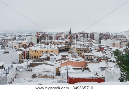 Landscape Of A Snowy Town With A Medieval Church. Landscapes And Winter Concept