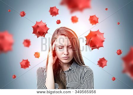 Young Woman With Long Hair Having Headache Standing Over Gray Background With Blurry Red Virus Molec