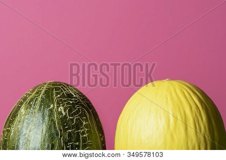 Two Sweet Melons On Pink Background. Green And Yellow Melons. Fresh Summer Fruits. Honeydew Melon An