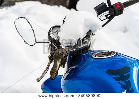 Winter Season And Snow On A Motorcycle Parked In Downtown Of Bucharest, Romania, 2020