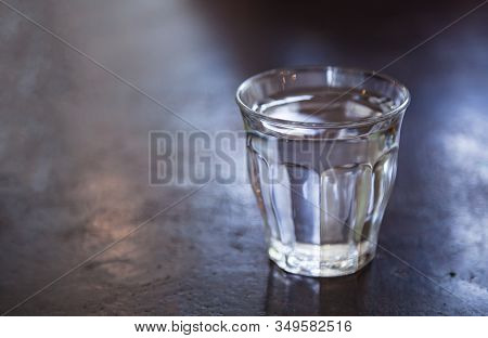 A Glass Of Room Temperature Drinking Water On The Stone Table Background. Refreshment, Drink Mild Cl