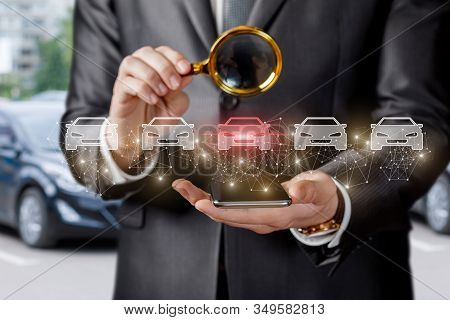 Concept Selection And Inspection Of A Car. A Businessman Is Looking At A Selected Car Through A Magn
