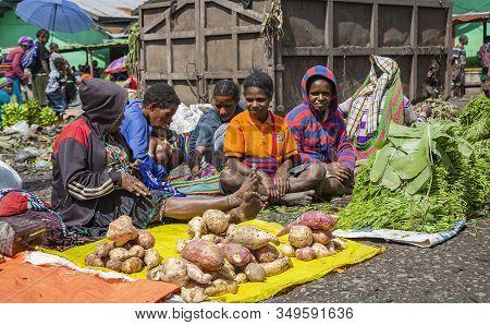 Indonesia, Papua New Guinea, Wamena, Irian Jaya, 20 August 2019: Papuans Woman Sell Sweet Potatoes A