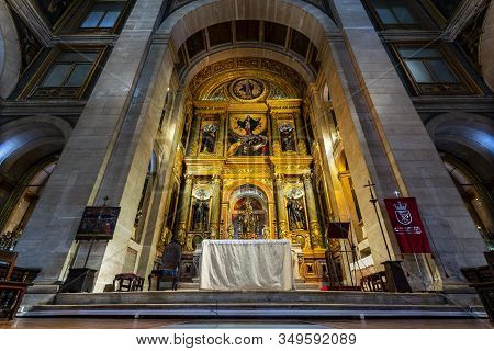 Lisbon - August 28, 2019: View Of The Chancel With A Gilded Altar Piece And Representation Of The Je