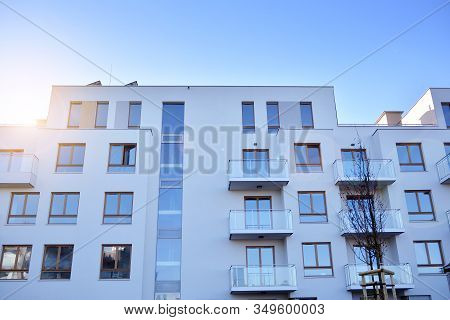 Sun Rays Light Effects On Urban Buildings. Fragment Of Modern Residential Apartment With Flat Buildi