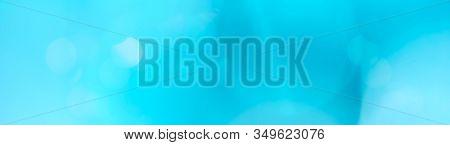Panoramic Simple Light Cerulean Blue Bokeh Background. Website Header Background Theme.
