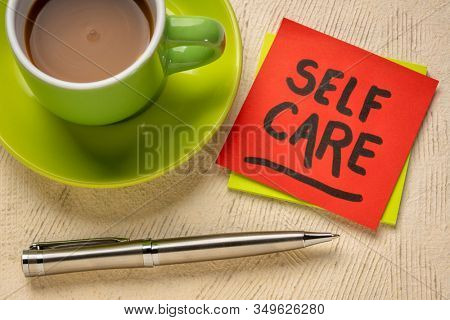 self care reminder note with coffee - health, wellbeing and lifestyle concept
