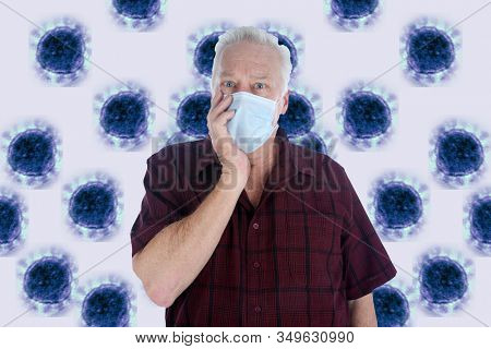 2019 Novel Coronavirus. 2019-nCoV. Wuhan, China 2019 Novel Coronavirus. A hospital patient wearing a paper mask is scared of contracting the CORONAVIRUS. Room for text. Coronavirus image in back.