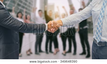 Close Up Of A Business Hand Shake Between Two Colleagues - Greeting, Dealing, Merger And Acquisition