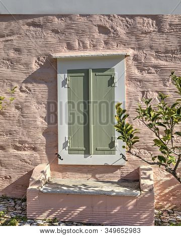 Green Woooden Window On A Rough Pink Paint Wall Textured Background. Stock Image