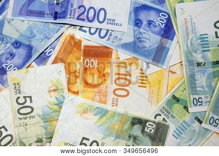 Israeli Money Stack Of The New Israeli Money Bills (banknotes) Of 50, 100 And 200 Shekel Background.