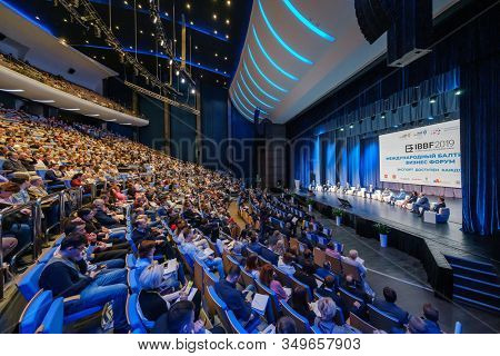 Svetlogorsk, Russia - October 11, 2019: Business conference attendees sit and listen to lecturer at hall, top rear view