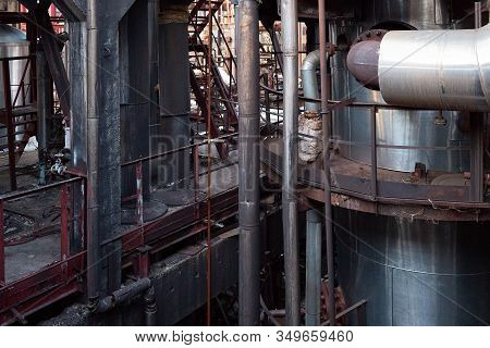 Old Factory Chemical Plant Metal Structures. Industrial Plant With Rusty Pipes And Thermal Insulatio