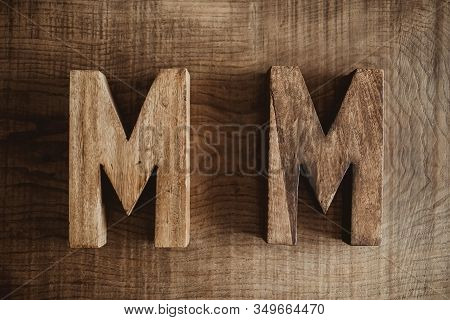 Two M Letters Made Of Wood. Name And Surname, Family Name Initials. Carpentry Business Background.