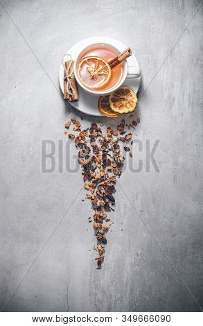 Fruit Tea With Cinnamon And Dried Orange In Cup - Teacup Isolated On Gray. Topview, From Above