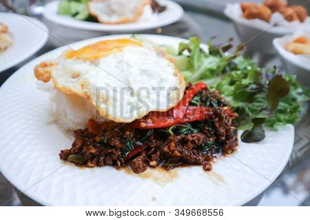 Stir Fried Pork With Holy Basil Or Rice Topped With Stir Fried Pork And Basil