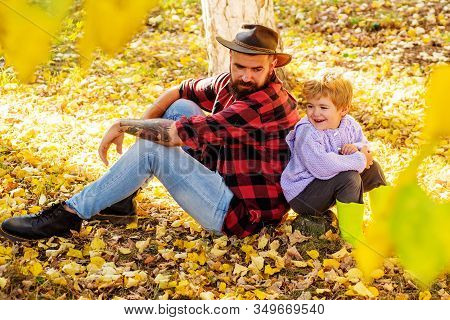 Father And Son Camping. Little Boy With His Father In Autumn Outdoors.happy Joyful Father With A Cut