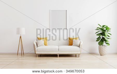 Blank Frame In Bright Modern Living Room With White Sofa, Floor Lamp And Green Plant On Wooden Lamin