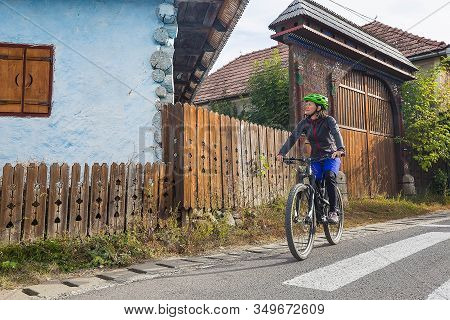 Young Brunette Woman Riding In The Vintage Town