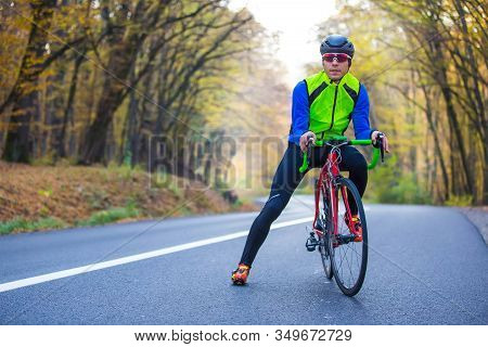 Young Man In Bikers Clothes Riding A Racing Bicycle