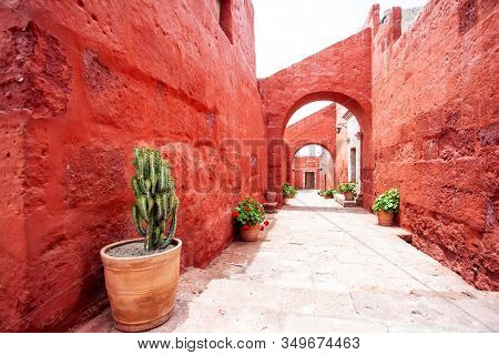 Arches On The Streets In The Monastery Of Santa Catalina, Arequipa, Peru, Cacti And Geraniums In Pot