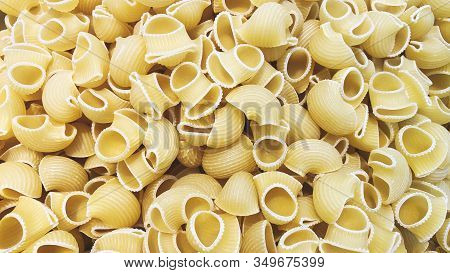 Variety Of Types And Shapes Of Italian Pasta. Dry Pasta Background.