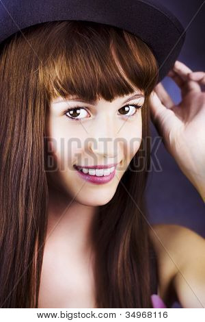 Portrait Of Beautiful Smiling Woman With Hat